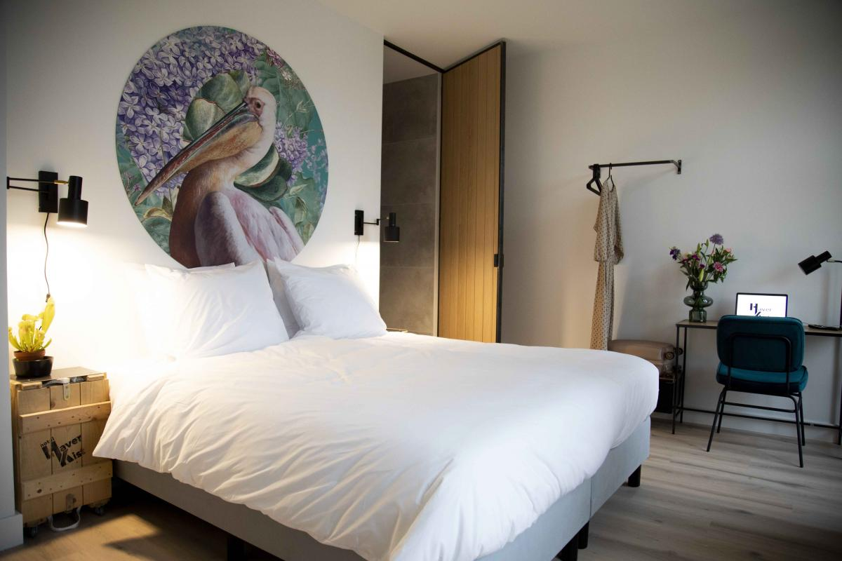 A cozy hotel room in the centre of the city with wooden elements and artsy wall circle